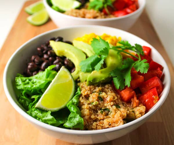 These Quinoa Burrito Bowls can be made in 15 minutes and are Vegan and GlutenFree! | Tastefulventure.com