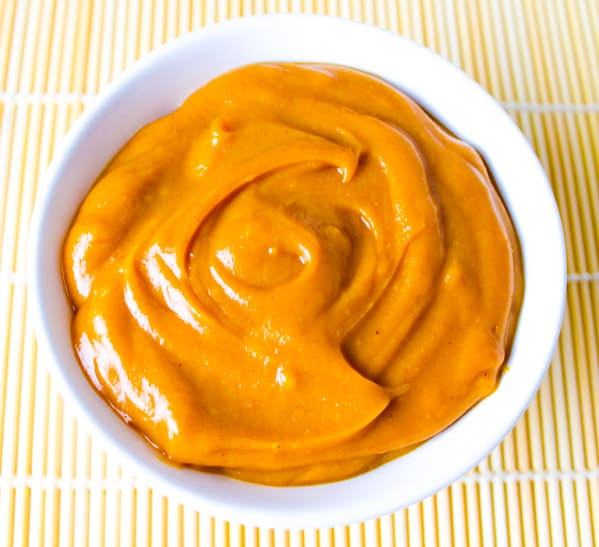 This Spicy Peanut Sauce is super easy to make and is Gluten free! We used coconut peanut butter, soy sauce, rice vinegar, honey, ginger, lime, and chili sauce.   Tastefulventure.com