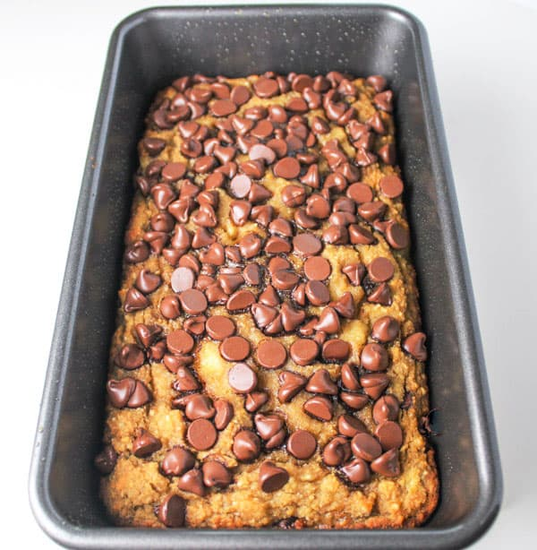 This Chocolate Chip Banana Bread (Gluten Free) is so easy to make and is so delicious! No sugar added! We used honey and very ripe bananas to make this sweet. | Tastefulventure.com