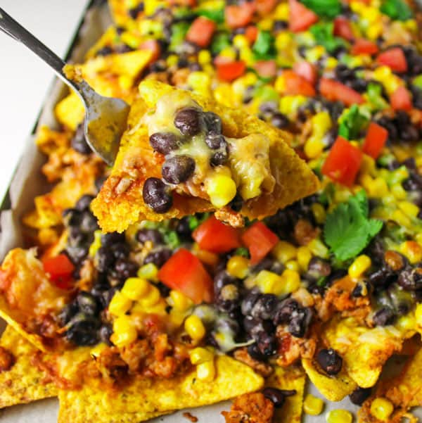Loaded Chicken Nachos that can be eaten as a meal or a snack, so addicting and Gluten Free! by Tastefulventure.com