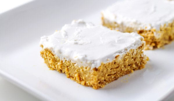 Paleo Pumpkin Bars with Coconut Whipped Cream Frosting, a favorite low calorie delicious Paleo dessert! | Tastefulventure.com