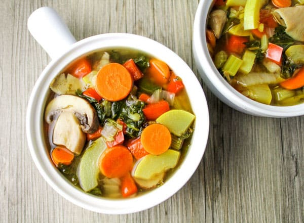 This Skinny Kale Vegetable Soup only has 40 calories per serving and is so delicious! This soup is loaded with Kale, Carrots, Zucchini, Red Pepper, Mushrooms, Celery, and Spices. | Tastefulventure.com