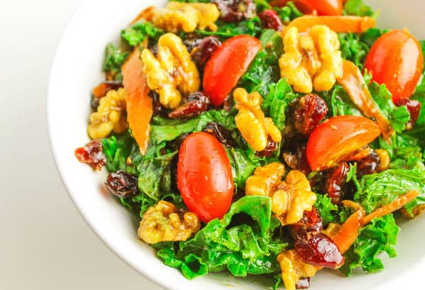 This Winter Kale Walnut and Cranberry Salad is so hearty, healthy, and full of Vitamin C. We made a home made Balsamic Vinaigrette Dressing to go with this that only takes 5 minutes to make! | Tastefulventure.com