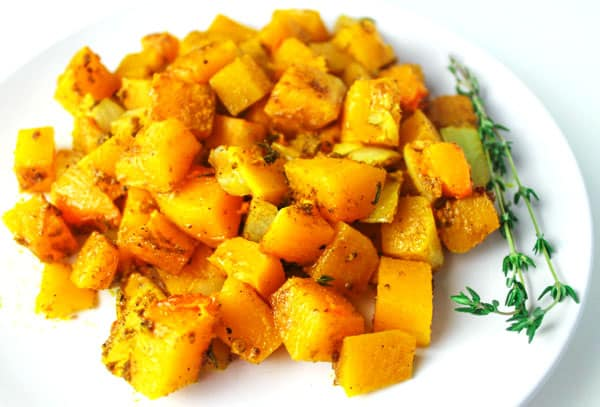 Baked Butternut Squash, a simple healthy side dish. You can make this ahead of time and then add to a crockpot on low heat for a crowd pleasing favorite! | Tastefulventure.com