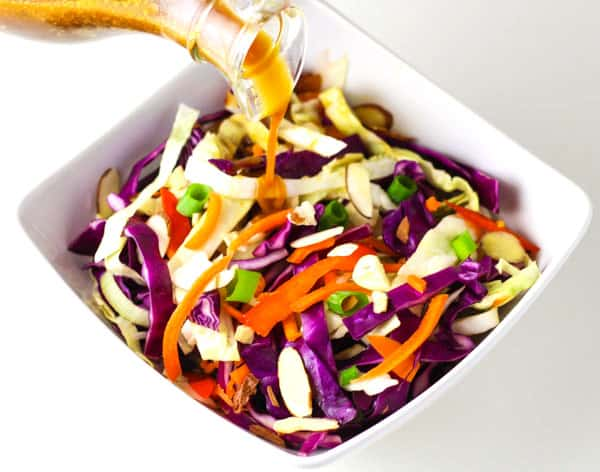 This Asian Slaw is so easy to make and is a crowd favorite! | Tastefulventure.com