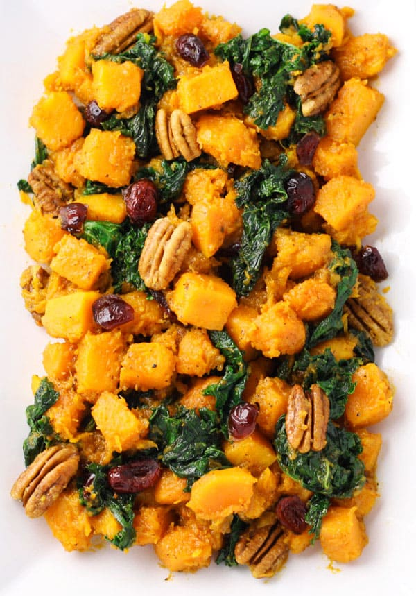 This Butternut Squash and Kale Stir Fry with Maple Vinaigrette comes together in under 30 minutes, it's one of my favorite fall side dishes to make! | Tastefulventure.com