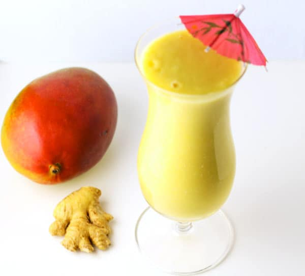 This Coconut Mango Ginger Smoothie is so creamy and delicious, plus it's Dairy Free!   Tastefulventure.com
