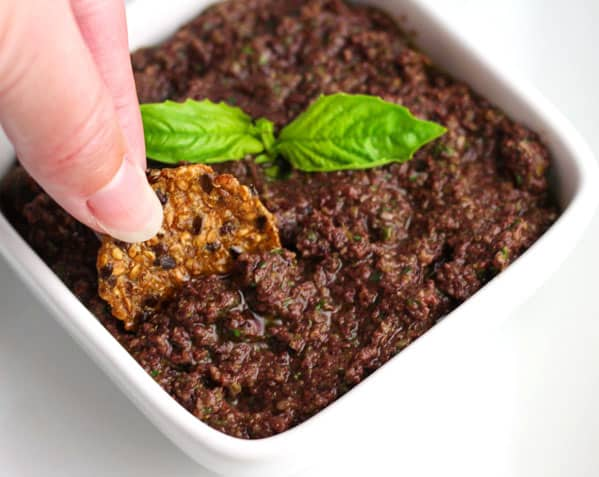 This Easy Fresh Tapenade is a crowd favorite! Just add everything to a food processor and blend, this appetizer can be ready in less than 5 minutes! | Tastefulventure.com