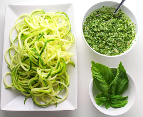 This Vegan Kale Pesto with Zucchini Noodles can be made in under 10 minutes! It's so healthy and delicious, around 300 Calories per serving and Low in Carbs! | Tastefulventure.com