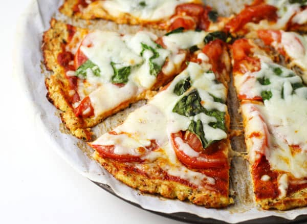 This Margherita Pizza with Cauliflower Crust tastes just like pizza without all of the calories or carbs! It's a great Gluten Free option as well! | Tastefulventure.com