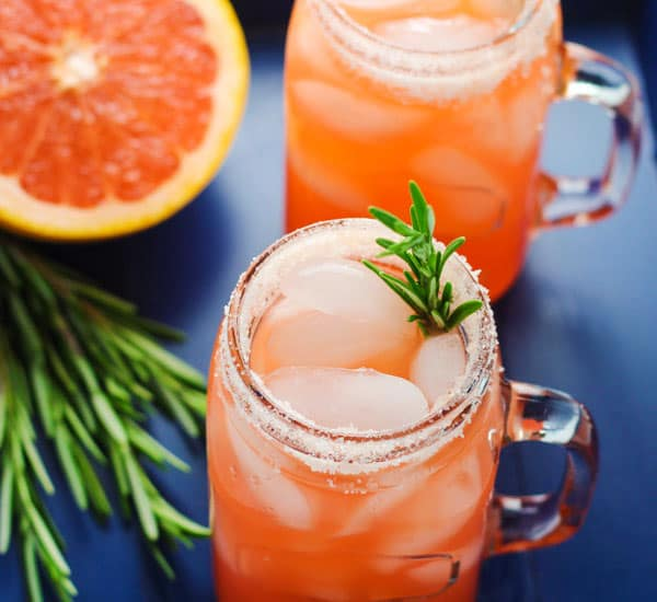 These Mason Jar Salty Dog Cocktails are so refreshing on a hot day, we added a sprig of Rosemary to give these a unique flavor! | Tastefulventure.com