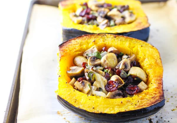 Roasted Acorn Squash Stuffed with Sage, Mushrooms, and Cranberries. This is a fall favorite! GF, V, and Paleo. | Tastefulventure.com