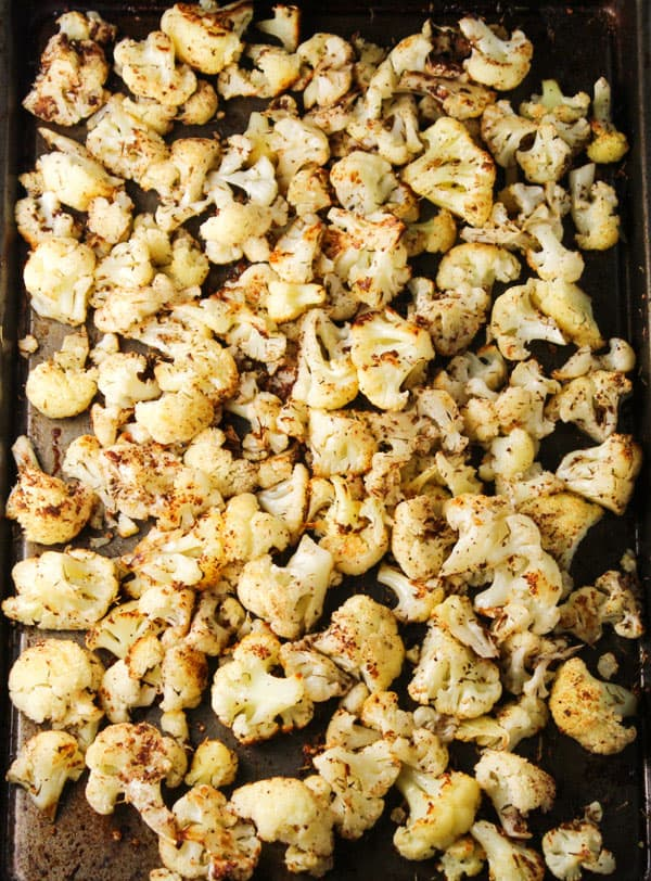 This Roasted Garlic Cauliflower is loaded with Vitamin C and only has 56 Calories per serving! Tastes so delicious and is guilt free! | Tastefulventure.com