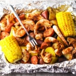 This Shrimp Boil in Foil is super easy to make. Just put everything in the foil, wrap it up, and bake it. This makes cleanup a breeze!   Tastefulventure.com