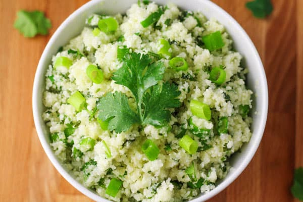 "This Skinny Cilantro Cauliflower ""Rice"" has around 17 calories per serving and is Low Carb! 