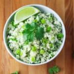 """This Skinny Cilantro Cauliflower """"Rice"""" has around 17 calories per serving and is Low Carb!   Tastefulventure.com"""