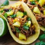 These Slow Cooker Hawaiian Chicken Tacos are a crowd favorite!   Tastefulventure.com