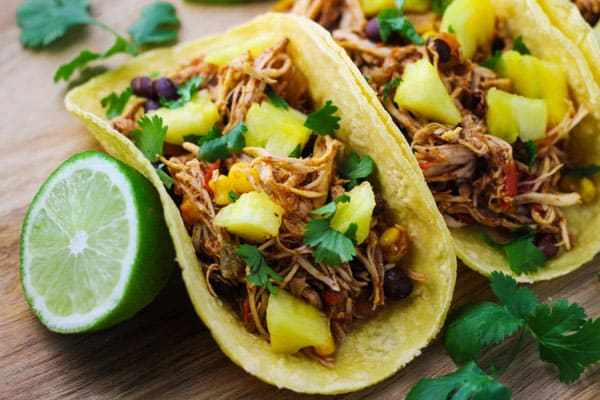These Slow Cooker Hawaiian Chicken Tacos are a crowd favorite! | Tastefulventure.com