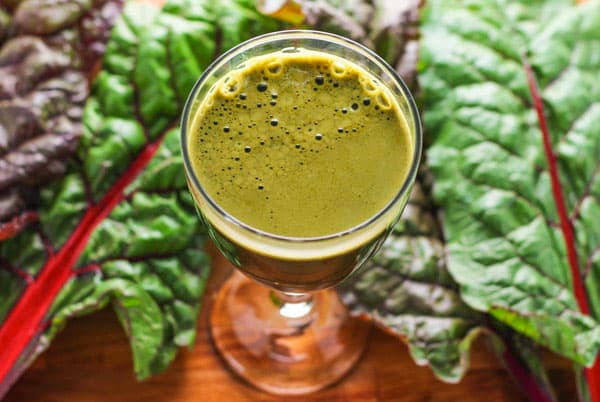 Somewhere Over The Rainbow Chard Juice - This juice is naturally energizing with Ginger, Carrots, Cucumber, Apple, and Rainbow Chard Leaves. | Tastefulventure.com