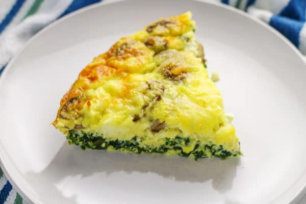 This Spinach Feta Mushroom Quiche (Crustless) is a crowd favorite! We made this 'Crustless' so it's Gluten Free! | Tastefulventure.com