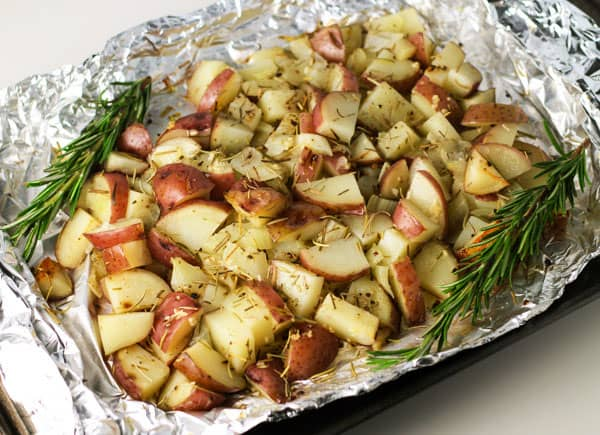 Top 10 Recipes To Make For Memorial Day - Roasted Red Potatoes with Rosemary, wrap everything up in a foil packet and bake or grill!