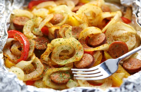 #ad - These Cajun Spiralized Potatoes and Sausage Foil Packets come together in 15 minutes! Just add everything to a foil packet and bake or grill, this makes for easy cleanup too! | tastefulventure.com made in partnership with @PotatoGoodness #Potatoes #CLVR