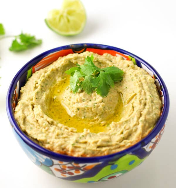 This Cilantro Lime Hummus is made with simple, healthy ingredients, and is a crowd favorite! | Tastefulventure.com