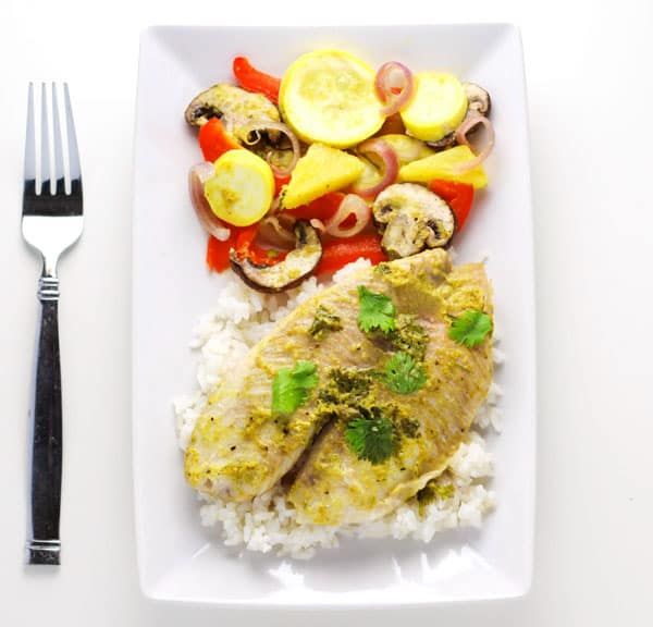 This Coconut Curry Tilapia With Zucchini Medley is so easy to make! Just add everything to a foil pack and bake or grill for a fresh healthy meal!