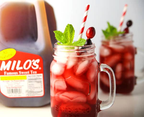 #ad - Cranberry Ginger Iced Tea made with Milo's Sweet Tea. This is the perfect holiday drink for your next party! #PassTheMilos #Pmedia