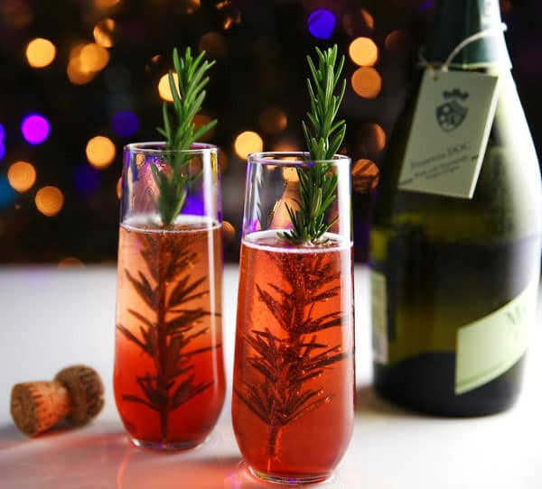 Cranberry Rosemary and Prosecco Cocktail - This is the perfect Holiday Cocktail and is so easy to make!