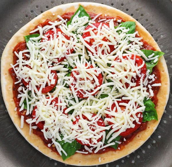 This Easy Margherita Pizza is Gluten Free and tastes so delicious! Only 5 ingredients needed!