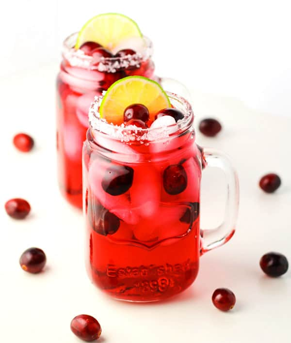 Festive Cranberry Margarita, perfect for any Holiday or get together, these are a crowd favorite! | Tastefulventure.com