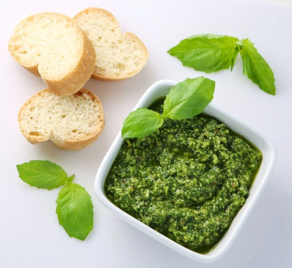 How To Make Basil Pesto - This is so easy to make and tastes so delicious! Dip your favorite bread in it, add it to pizza, or mix in with pasta!