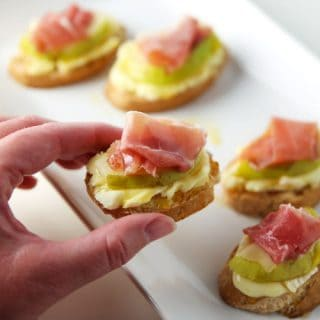 Prosciutto Pear Brie and Honey Crostini