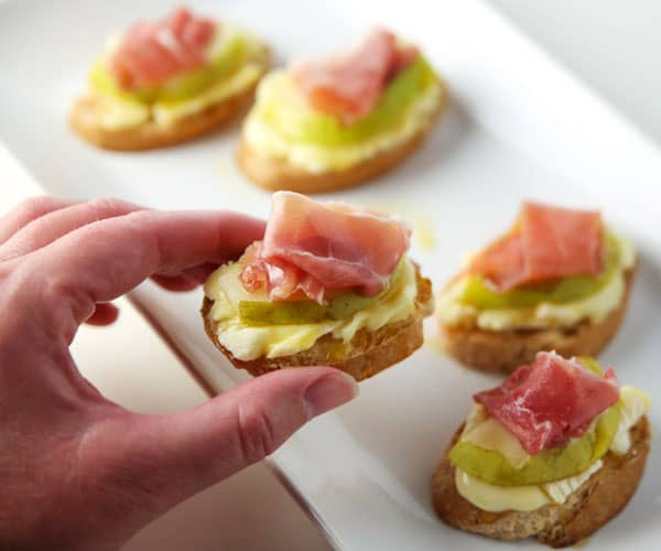 Prosciutto Pear Brie and Honey Crostini (GF) - This is such an easy appetizer to throw together at the last minute and is so delicious!
