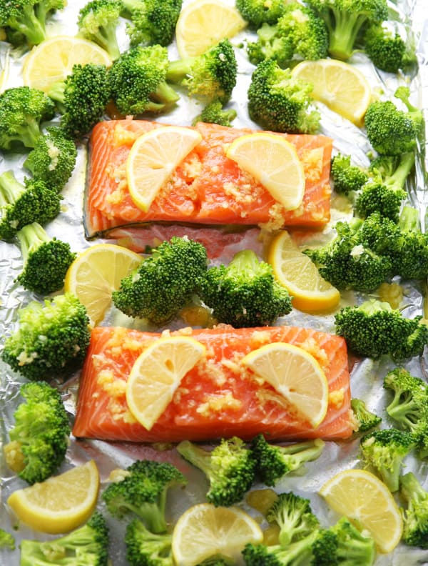 This Sheet Pan Lemon Garlic Salmon With Broccoli can be made in under 20 minutes! The Salmon is so tender, flaky, and delicious!
