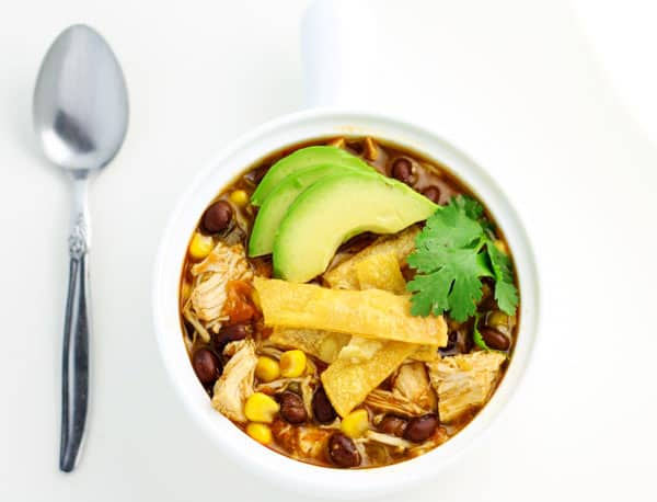 This Slow Cooker Chicken Tortilla Soup is a family favorite! This is loaded with flavor, plus it's Gluten Free! | Tastefulventure.com