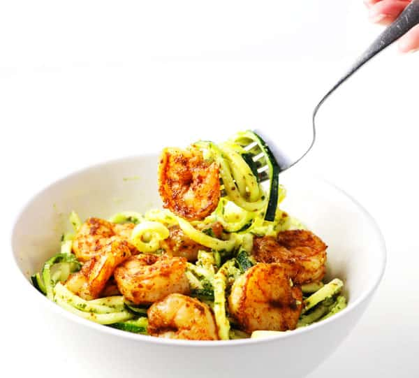 Spicy Shrimp With Basil Lime Pesto Zoodles ~ This can be made in less than 10 minutes and is so delicious! We spiralized Zucchini to make this a low carb, gluten free, 'noodle' alternative!