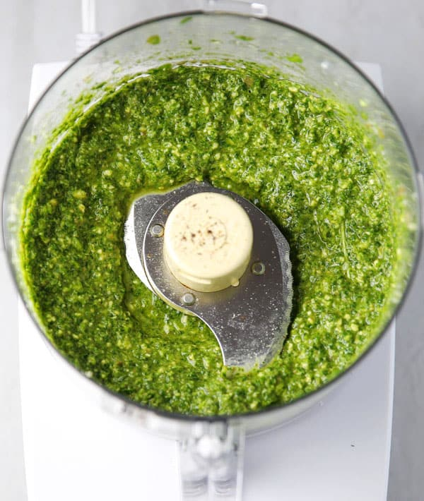 This Arugula Pesto is made with simple fresh ingredients and is way better than any store bought pesto! It's great on pasta, bread, or even pizza!