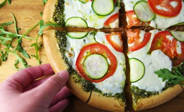 This Arugula Pesto Pizza with Tomato and Zucchini is so light, refreshing, and loaded with flavor! (Gluten Free)
