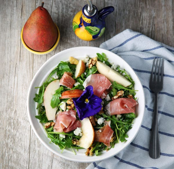 This Arugula Prosciutto Pear Salad with Gorgonzola and Walnuts has the perfect harmony of flavors! This probably one of the most delicious salads I've ever had!