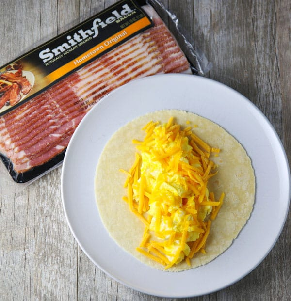 #ad Putting a new spin on Breakfast with this easy Bacon Wrapped Breakfast Burrito! Tastefulventure.com made in partnership with @SmithfieldBrand #BreakfastReimagined