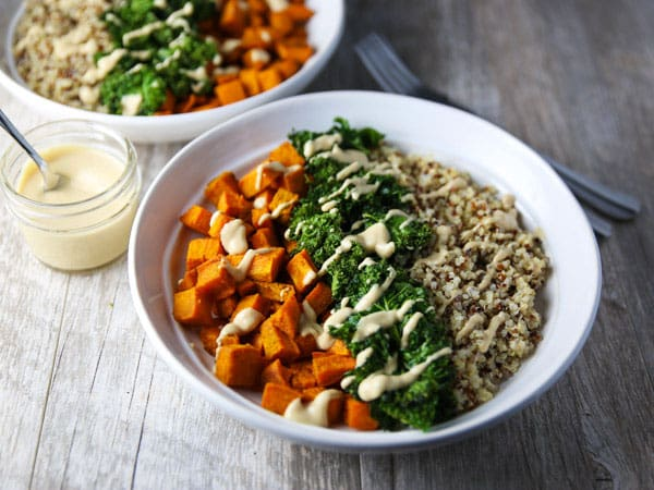 These Healing Turmeric Sweet Potato Kale Quinoa Bowls are loaded with goodness! Topped it with a Lemon, Tahini, Maple Syrup Dressing for the win!