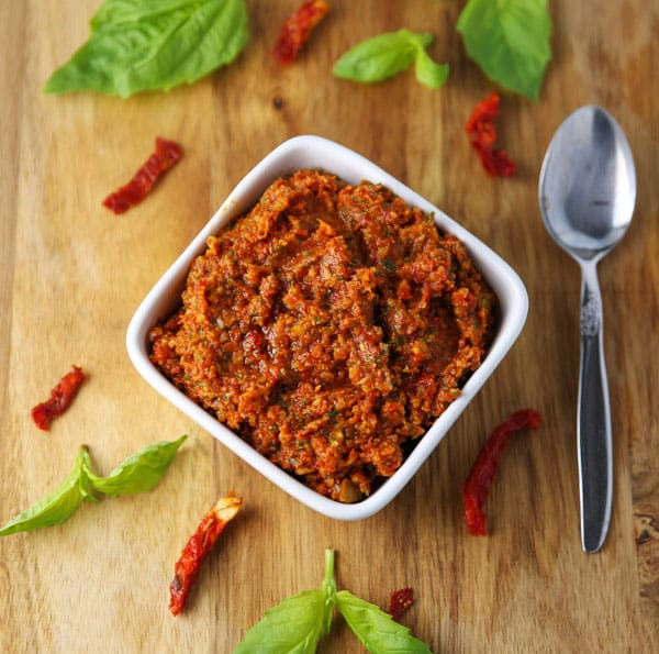 How To Make Sun-Dried Tomato Pesto - This can be made in 5 minutes and is way better than any store bought pesto! Add it to pasta, pizza, crostini... the possibilities are endless!