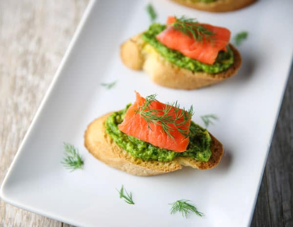 These Smoked Salmon Avocado Dill Crostini appetizers are so easy to make and are so tasty! This is a hit at any party!