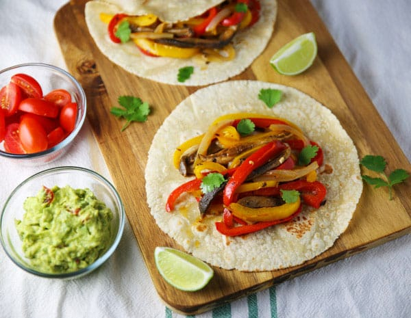These Veggie Fajita Tacos are super easy to make, filling, and loaded with flavor!