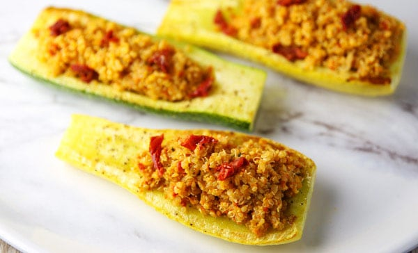 Sun-Dried Tomato Pesto Quinoa with Roasted Zucchini - This is so light, refreshing, and loaded with flavor! Perfect as a meal or a side dish!