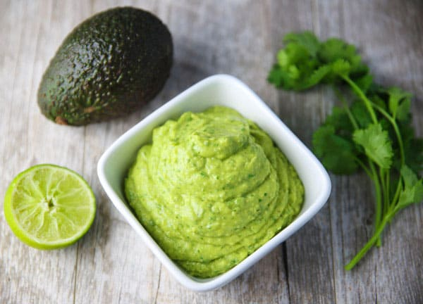 This Avocado Cilantro Sauce is made with simple fresh ingredients and is so addicting! This is great as a dip, or top it onto your favorite Mexican dish!