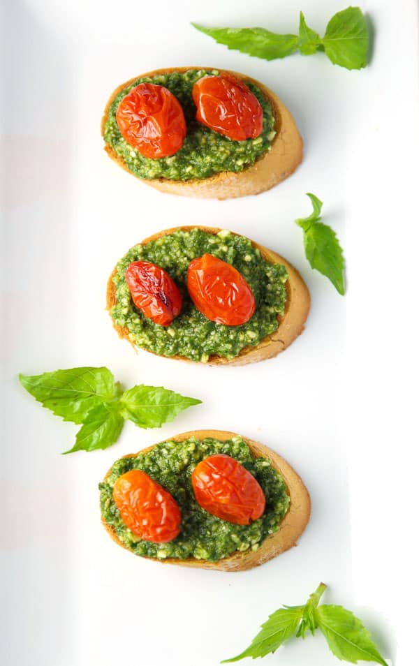 These Basil Pesto Crostini with Roasted Tomatoes are such an easy appetizer to make and a crowd favorite!