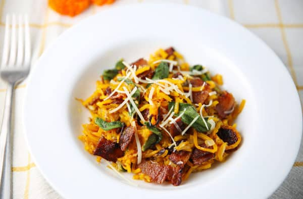 Butternut Squash Noodles with Bacon and Sage - This is a great gluten free alternative to noodles by spiralizing Butternut Squash into noodles! The flavors of the Squash with the Bacon and Sage are totally drool worthy!